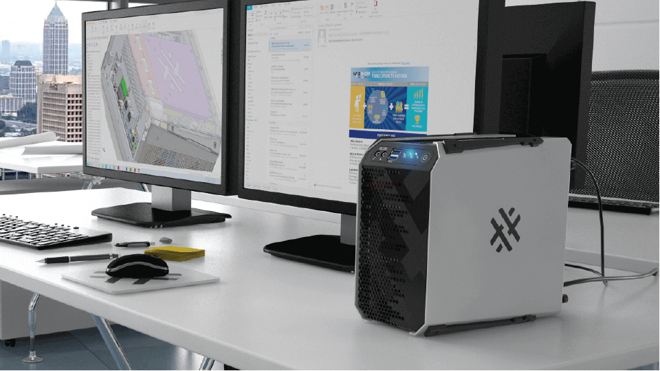 APEXX 1 system sitting on a desk in an office that overlooks a city